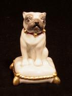 Small Cream Porcelai  Pug seated on cushion