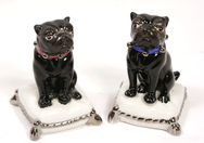 Black Porcelain Pug Sitting on Cushion