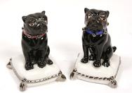 Black Porcelain Pug Sitting on Cushion